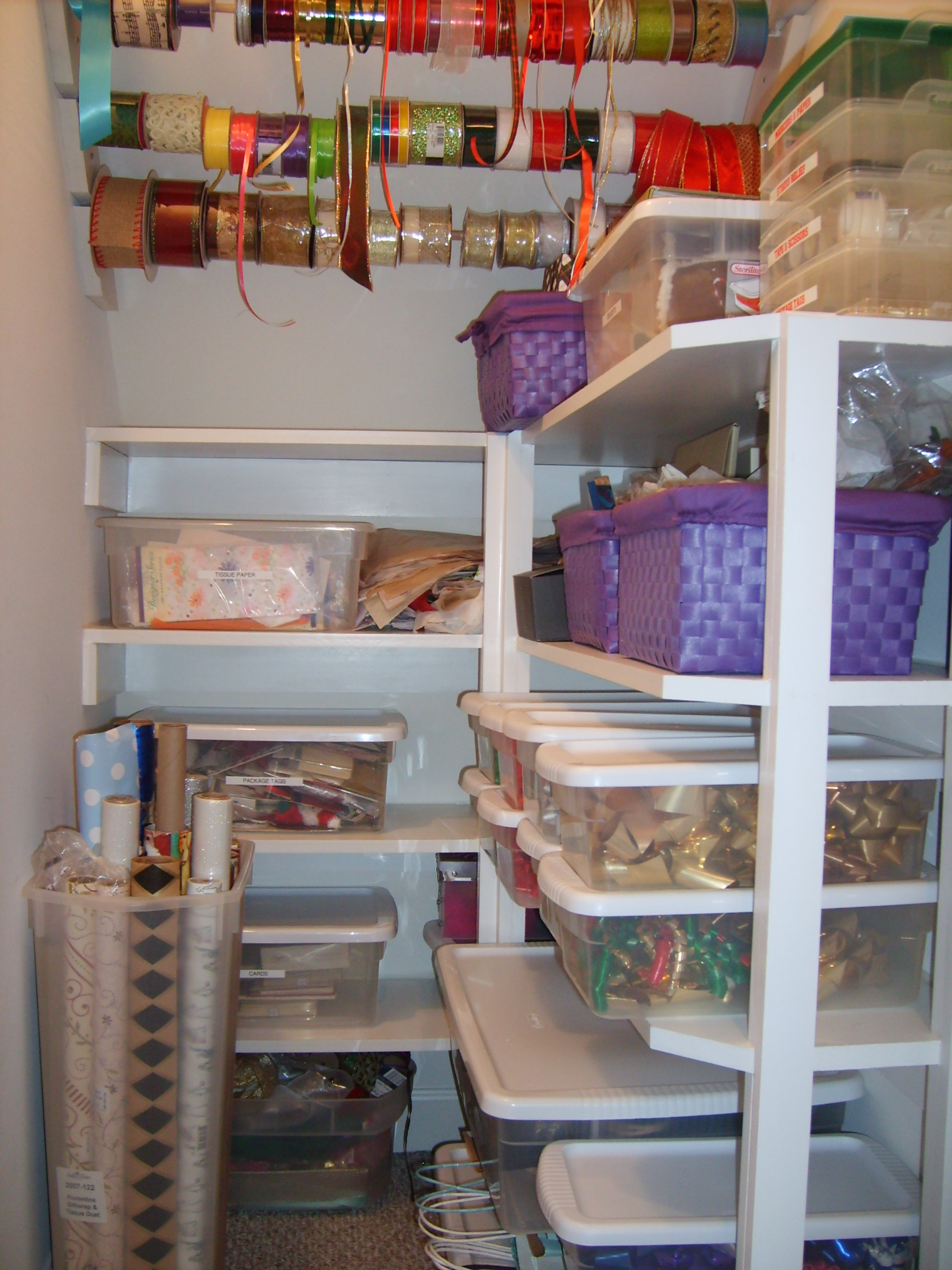 Gift wrap storage ideas - There Is Also Lots Of Shelf Storage For Ready Made Bows Rolls For Gift Wrap Gift Tags Tissue Paper Gift Bags And Boxes Even Some Space For Those